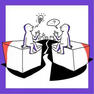 Kaksi matkailutoimijaa istuu laatikoiden päällä ja keskustelee. Takana näkyy kaupunki. Kuvan kehys on violetti.