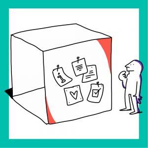 Matkailutoimija tarkastelee laatikkoon kiinnitettyjä ilmoituksia. Kuvan reunus on vihreä.